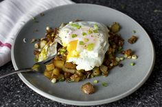 bacon corn hash, broken egg.