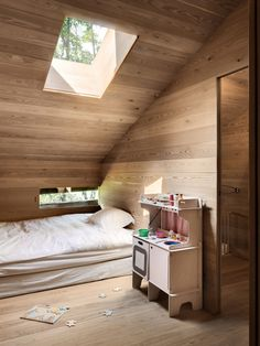 Nestled in the Sarreyer hillside, just beyond a charming village in the Swiss Alps, is a tiny cabin. Designed by Vevey-based firm, Rapin Saiz Architects, the. Old Cabins, Tiny Cabins, Lake Cabins, Cabin Design, Bed Design, Timber Panelling, Oak Panels, Wooden Stairs, Tiny House Movement