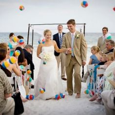 """Fun idea for beach weddings: Give each guest a small beach ball to toss after you say """"I Do!"""""""