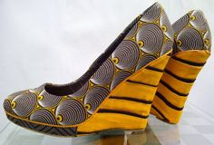 African Print has permeated all facets of fashion. I love all the ways it pops up, but I especially love the print on shoes because it's such a refreshing and nouvelle concept. An African printed s. African Wear, African Fashion, African Inspired Clothing, African Clothes, Striped Shoes, Bold Fashion, Fashion Shoes, Fashion Accessories, Africa