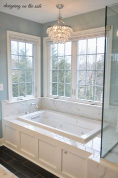 Master Bath, marble tile, SW Rain, crystal chandelier, tile that looks like hardwood, wainscoting tub
