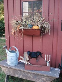 Enhance your garden shed by adding window boxes. You can change up your display according to the season. Add broom corn, bittersweet, gourds and pumpkins in the fall or fresh cut greens in the winter. Primitive Autumn, Primitive Decor, Primitive Country, Fall Window Boxes, Garden Windows, Happy Fall Y'all, Fall Harvest, Harvest Time, Flower Boxes