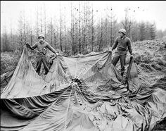 Two American soldiers examine a German parachute found in an area where German paratroopers were dropped at the beginning of the Ardennes offensive in December 1944. American Soldiers, American Civil War, Ardennes, Paratrooper, Historical Images, North Africa, Us Army, World War Two, Wwii