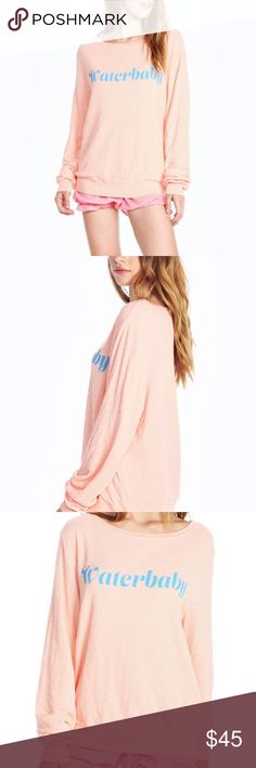 Wildfox Waterbaby Lightweight Beach Jumper Stay hydrated in this waterbaby baggy beach jumper. Super soft sweater featuring a roomy, relaxed fit that hangs off the body perfectly. Scoop neck and banded hems. Wildfox Sweaters Crew & Scoop Necks