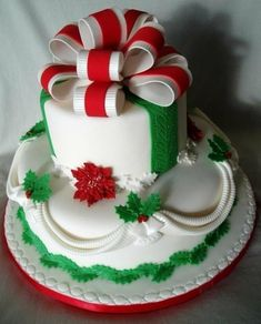 A beautiful Christmas wedding cake with double bow.