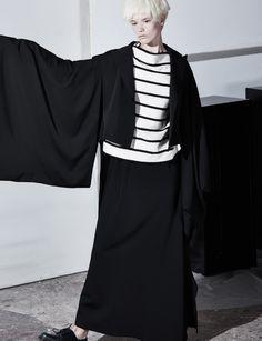 Jacket and skirt: Yohji Yamamoto Top: Forte Forte shoes doc martens