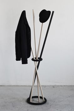 Poke Hanger gravity-defying coat rack by Kyuhyung Cho