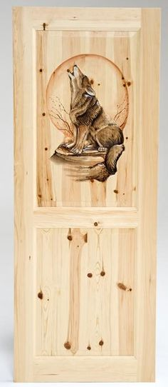Hand carved door featuring a howling wolf by Woodland Creek Furniture