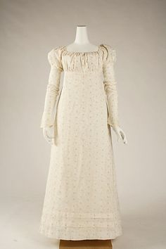 Dress  Date: 1810–15 Culture: American Medium: cotton Dimensions: Length at CB: 52 in. (132.1 cm) Credit Line: Gift of Mrs. Helen S. Gulick, 1999 Accession Number: 1999.224