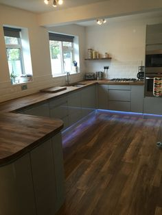Our howdens grey gloss kitchen with american black walnut Grey laminate kitchen worktops