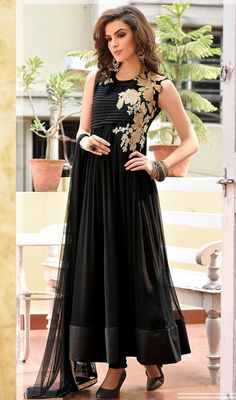 Exhibit the exuberance in your classic looks owning this black chiffon long Anarkali churidar suit. The charming floral patch, lace and resham work a substantial element of this dress. #CharmBlackNetAnarkaliSuit