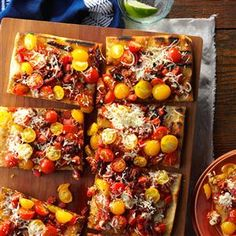 Triple Tomato Flatbread Recipe -Tomatoes are the reason I have a vegetable garden, and I developed this recipe as a way to show off my plum, sun-dried and cherry tomatoes. It's so easy, and will absolutely impress. —Rachel Kimbrow, Portland, Oregon