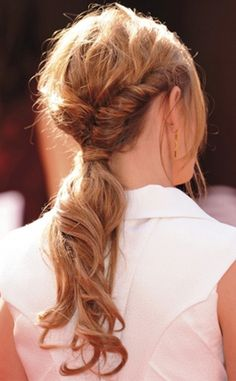 twisted pony...my hair isn't long enough to do this but @Katie Baumann we should try this on your hair