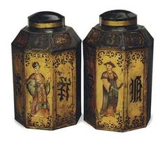 A PAIR OF ENGLISH BLACK AND GILT-DECORATED TOLE PEINTE TEA CANNISTERS,