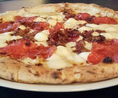 I can't say enough good things about the pizza at @canerossoaustin. It's just SO good. We opted for the off-the-menu Honey Bastard which includes mozzarella hot soppressata bacon marmalade and habanero-infused honey. @canerossoaustin opens its doors tomorrow! Go get you some!