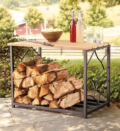 Outdoor Eucalyptus Storage Table With Steel Frame - might be good replacement for the plastic table, with wood storage for the fire pit