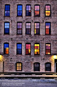The colored windows on the cold brick background are mesmerizing