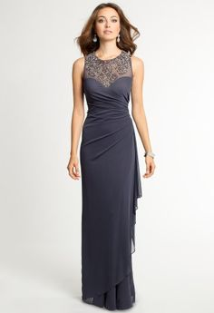 To all the ladies in the place with style and grace, this one's for you! This illusion embellished formal dress is just the right mix of classic elegance and modern elements to make it the perfect choice for all of your social events. The details include a diamond-studded neckline, a sheer matte jersey skirt and bodice, and a cascading ruffle flowing to the floor. Wear this evening dress with an illusion high heel, rhinestone embellished earrings, and a sleek handbag.   •Illusion and beaded…
