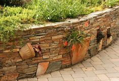 What a fabulous idea for a retaining wall - pots built right into the wall