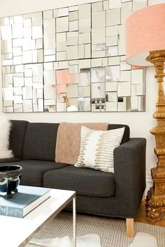 Mirrored wall art. LOVE. above drawers in dining room? not as rustic, but still fun!
