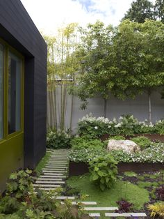 Stepstone's narrow concrete pavers add a graphic touch to the garden in the Mill Valley home of Dwell founder Lara Hedberg Deam and architect Chris Deam. Photo by Dustin Aksland. Photo by Dustin Aksland. This originally appeared in Designed In-House. Modern Backyard, Modern Landscaping, Garden Landscaping, Garden Path, Landscaping Ideas, Bamboo Garden, Moss Garden, Landscaping Software, Shade Garden