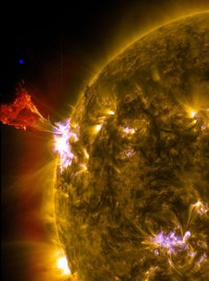 The Sun had a bit of a hissy fit on May 3, 2013. See that blue dot above the prominence? Thats about how big the Earth is. Photo by NASA/SDO.