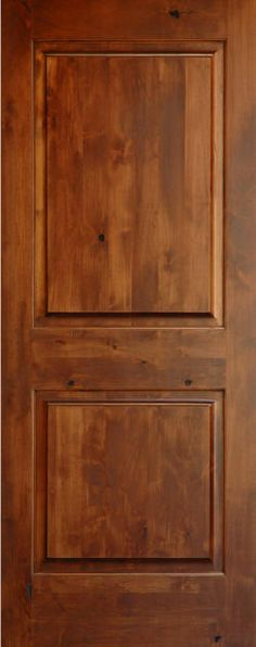 Knotty alder two panel solid core doors. No arch.