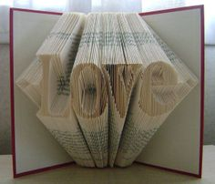 Folded book art, Love, recycled book by Dancing Grey Studio