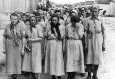"""Ravensbruck womens' concentration camp inmates weary after forced labour and being experimented on by Nazi doctors, and abuse from guards, and their own inmate """"trusties"""" working with the Germans, for better rations, and treatment. Many misused position to steal very last hidden possessions of others, and take out personal vendettas against those they didn't like."""