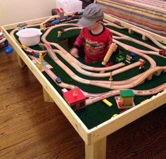 Custom made train / activity table - best part is the cut out in the center.