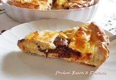 Crostata alla Nutella e crema pasticcera, un'ottimo dolce ideale per la domenica o festività. La crostata è golosissima anche come dolce da compleanno.