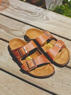 Free People Arizona Birkenstock, $120.00 in antique brown or black leather