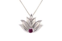 "Lotus Pendant – 14k White Gold  This pendant is 14k white gold with a pink tourmaline stone. It has a hidden bail which allows for it to fall simply and beautifully on the neck. It measures approximately 1″ x 1″ and comes with an adjustable 16- 22"" coordinating cable chain.  By #AndreaLoprestiFineJewelry"