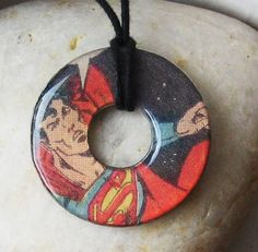 SUPERMAN Vintage Comic Book Upcycled Washer Hardware Pendant Necklace DC Comics Design 4. $9.50, via Etsy.