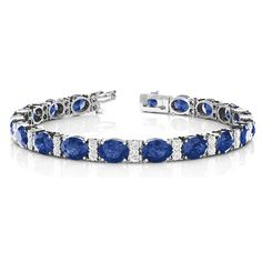 Oval Sapphire With Diamond Bracelets with Blue Sapphire in 14K White Gold exclusively styled by Fascinating Diamonds