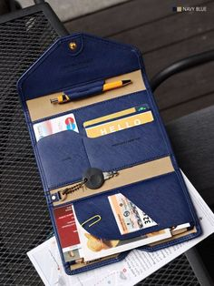 Great for travel, lots of places to put cards, travel documents, passport, and even has a pen holder!