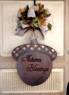 """Autumn Blessings Acorn Door Hanger (49.95) Acorn is approx 17"""" and hangs from large burlap bow. Personalize with name or monogram if desired. To order email engrave9@gmail.com Leaves may be added to bow. By Engravings Unlimited Hospital Door Hangers, Fall Door Hangers, Fall Porches, Wooden Door Signs, Door Hangings, Wreath Making, Burlap Bows, Porch Signs, How To Make Wreaths"""