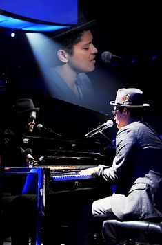Nice Bruno Mars picture playing the piano