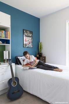 blue and gray boy\u0027s bedroom features a wall painted blue framing a