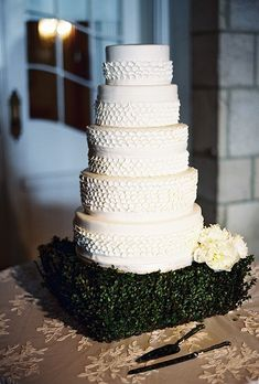 Caroline and Rascoe's chic wedding in Palm Beach, Florida, required an equally stunning wedding cake. So the couple asked the bakers at The Sugar Monkey to create this scalloped five-tiered vanilla treat for dessert.