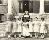 This 1956 photo taken in Normandy, Mo., shows Sister Hiltrudis with orphans who helped mark her 50th Jubilee celebration of being an Oblate Sister of Providence.