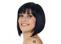I used to love Kym Ryder/(Marsh?) from Coronation Street with her cool hair (pre-implants)