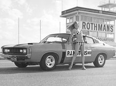 Kathy Ford posed with a Chrysler Valiant racing vehicle at the Surfers Paradise International Raceway, Carrara, Australian Muscle Cars, Aussie Muscle Cars, Weird Cars, Cool Cars, Chrysler Charger, Chrysler Valiant, Perth Australia, Coast Australia, Chrysler New Yorker