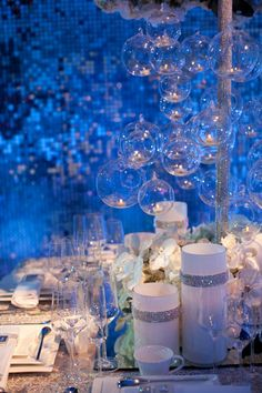 Using clear ornaments to capture the look of bubbles is a pretty good idea for a bridal shower