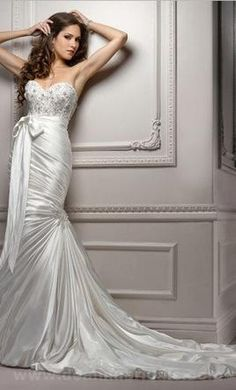 New With Tags Maggie Sottero Wedding Dress Mia, Size 4  | Get a designer gown for (much!) less on PreOwnedWeddingDresses.com