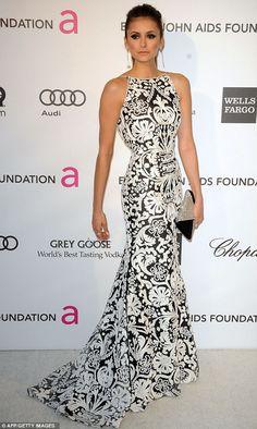 Nina Dobrev wore a Naeem Kahn dress with Barbara Bui shoes, Swarovski clutch, and Chopard jewelry.