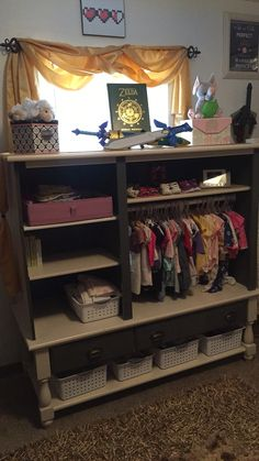 I turned an old entertainment center into my daughters closet storage. I love her legend of Zelda nursery!