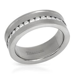 Ring With Cubic Zirconia - Size 8 Size 8. Superb gentlemens band ring with cubic zirconia well made in titanium. Total item weight 4.3g. Gemstone info: 33 cubic zirconias, 0.56ctw., round shape and white color.