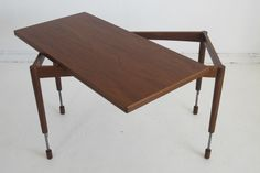 Hans Olsen Adjustable Height Dining/Coffee Table   From a unique collection of antique and modern dining room tables at http://www.1stdibs.com/furniture/tables/dining-room-tables/