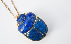Coronation Scarab of King Tut crafted of solid 14K gold and lapis lazuli by the Franklin Mint in 1977. An authentic re-creation of the 3300 year old gold scarab from the bracelets worn by King Tut's m